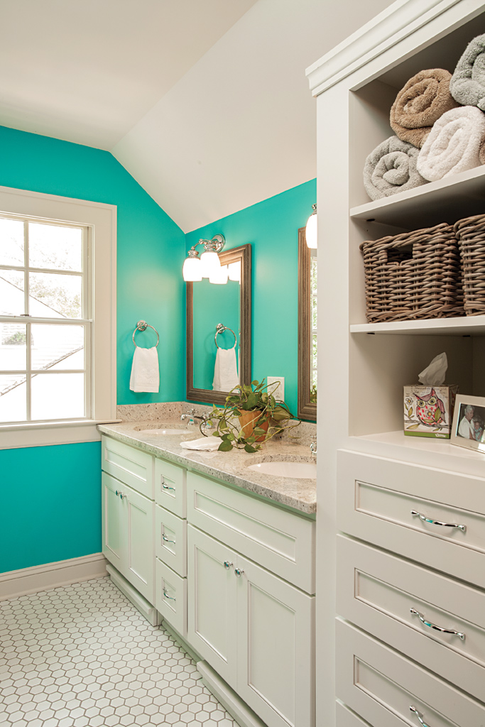 bathroom with shell color cabinetry and accent wall color. Black Bedroom Furniture Sets. Home Design Ideas