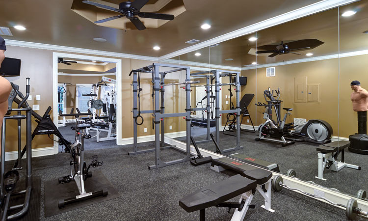 Home renovations before after articles atlanta home for Basement home gym design ideas