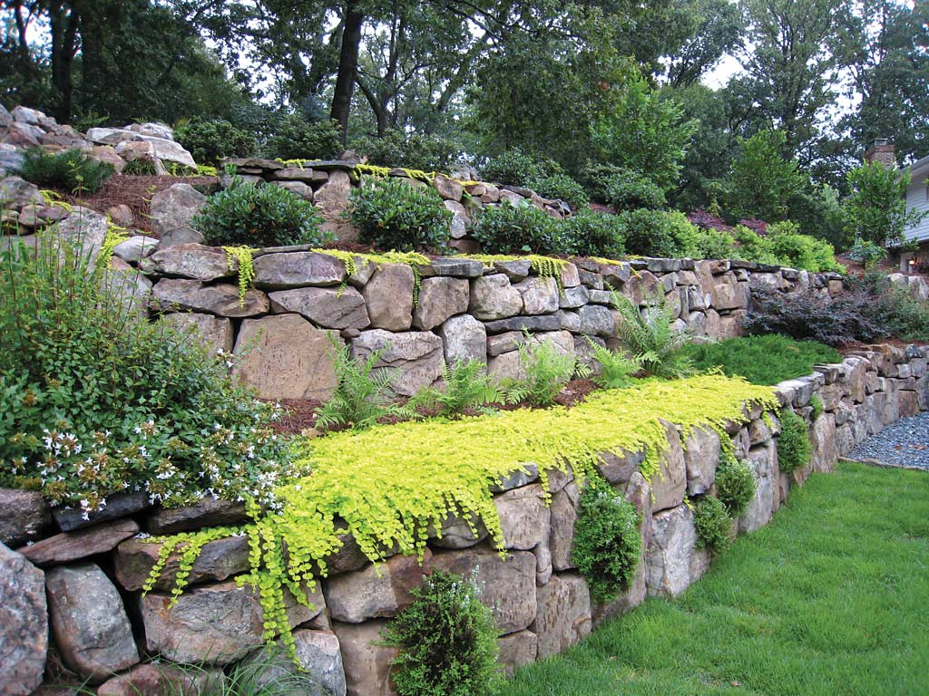 Retaining Walls Expand Landscaping Options on garage built in to hillside