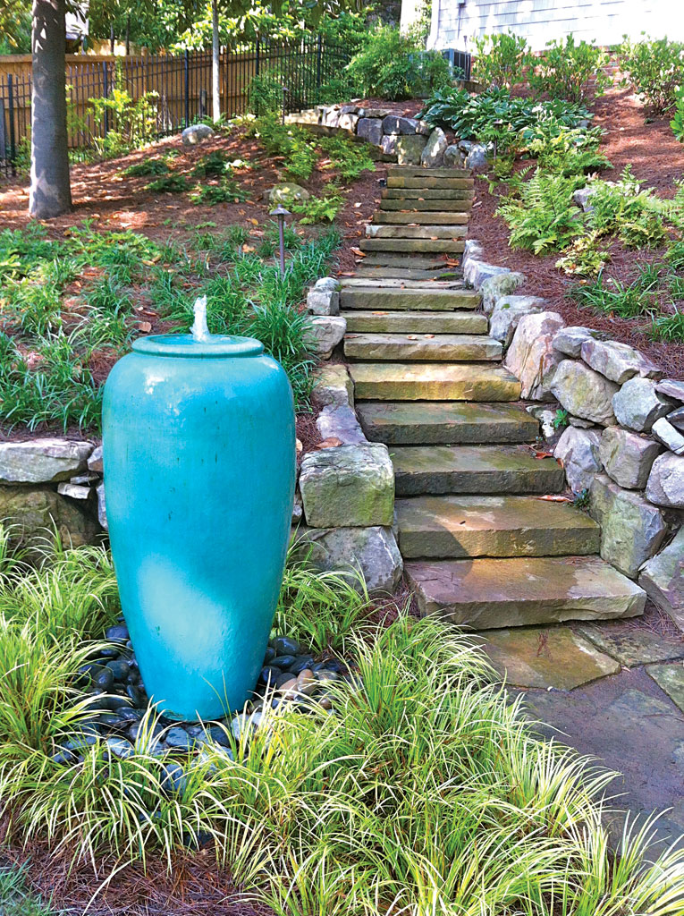 Garden With Blue Container Fountain