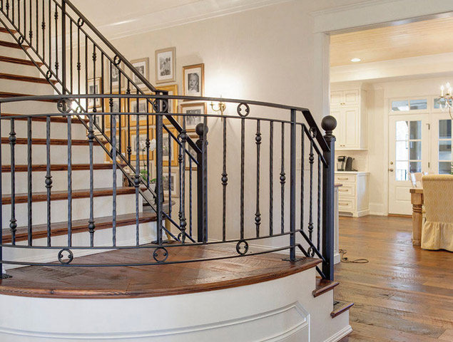 Gorgeous and elegant staircase with iron railing by Vision Stairway & Millwork