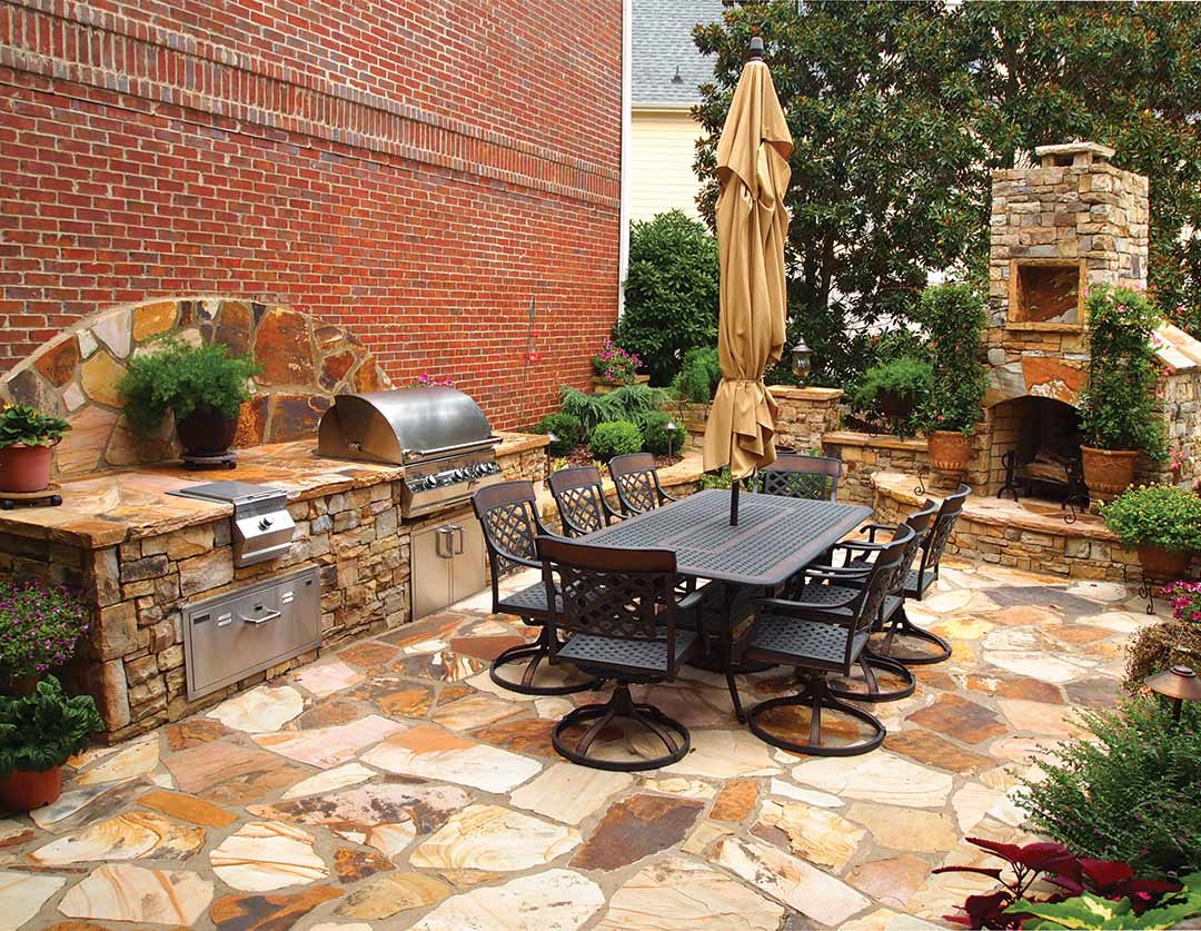 Outdoor kitchen trends take it outside atlanta home for Outdoor cooking area and fireplace