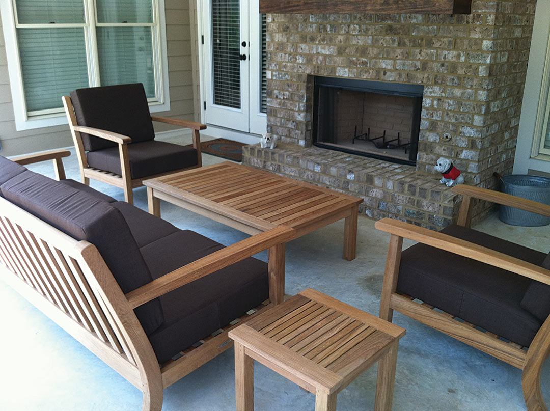 Deck With Teak Furniture Surrounding An Outdoor Fireplace