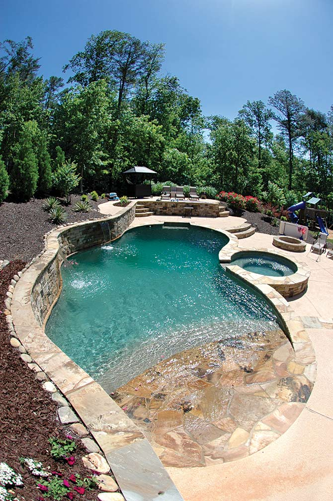 Create an oasis in your own backyard with a pool and spa for Walk in inground pool