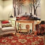 Room showing 2014 design trends - featuring clean lines in furniture, bold patterns in upholstered fabric and repositionable mural