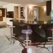 Basement design - close up of bar with Absolute Black granite and extra seating.