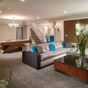 Basement remodel showing family room with modern furniture