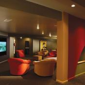 Basement design - media room, fun design for children with red and gold chairs and cool design elements such as arches and open spaces