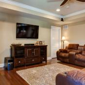 Basement design - home theatre with brown theater seats
