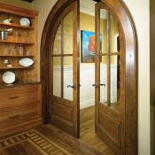 Dining room with french-styled door with an arched top