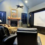 Room with theater seating and big screen TV