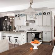 Beautiful kitchen with white cabinets and different lighting options