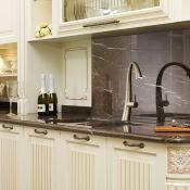 Kitchen with modern style faucet, cabinet handles and under cabinet lighting