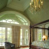 Master bedroom with french doors that lead to a deck