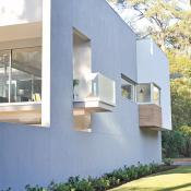 Modern design with deck protruding through wall of house