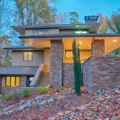 Modern design home with stack stone exterior