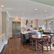 Open floor plan kitchen design by CSI Kitchen & Bath Studio