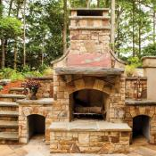Outdoor custom built stone fireplace