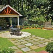 Landscape with pavers leading to patio area