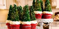 Cupcakes with frosting and edible Christmas Tree Toppers