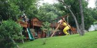 Treehouse with fort, slides and swings