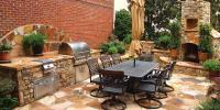 Beautful outdoor area to gather with family and friends with seating to dine, outdoor kitchen and fireplace