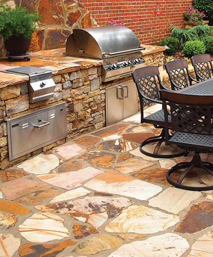 Outdoor kitchen with grill, burners, refrigeration and outdoor fireplace