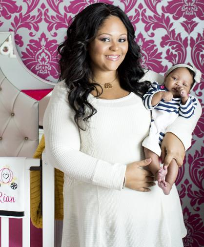 Decorating on a Dime contest winner, Alisha Nesbitt and her baby girl, Rian in the new nursery