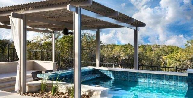 Patio, pool and spa covered with a louvered patio cover
