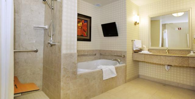 Bathroom designed with aging in place in mind - walk-in shower and vanities that can accommodate a wheel chair