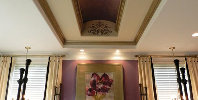 Bedroom with beautiful crown dome tray ceiling accented with gold pattern