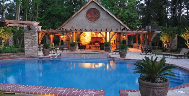 Outdoor living space with a pool and cabana