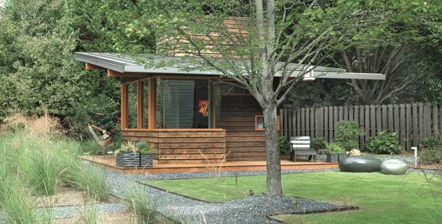 Modern landscape design with Maiden grass, azaleas and pebbles separating the garden in blocks
