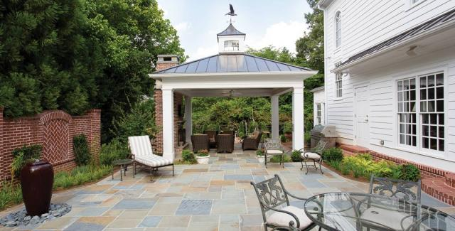 Outdoor living space with a pavilion, fireplace and grilling area