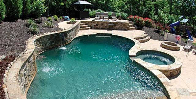 Create an oasis in your own backyard with a pool and spa for Pool design for sloped yard