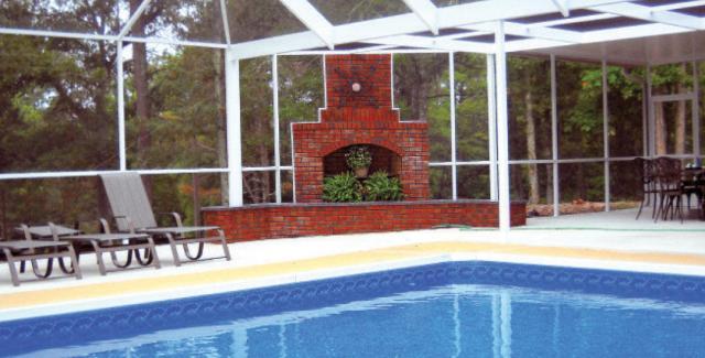 Screen lanai encloses pool