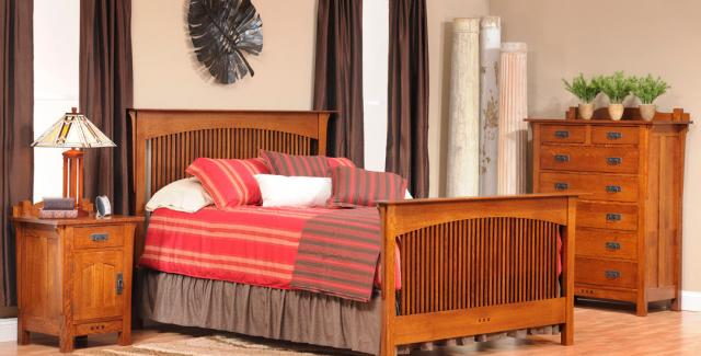 Bedroom design with spindle bed, seven drawer chest and bedside table