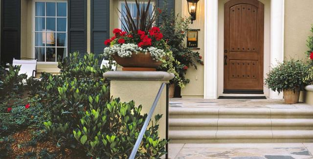 Home exterior - beautiful curb appeal with planters, container garden plants,  wooden front door and windows with shutters