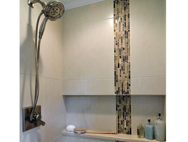 Close up view of shower tile and fixture