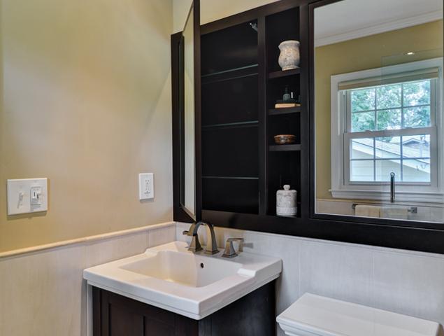 Storage behind vanity mirrors