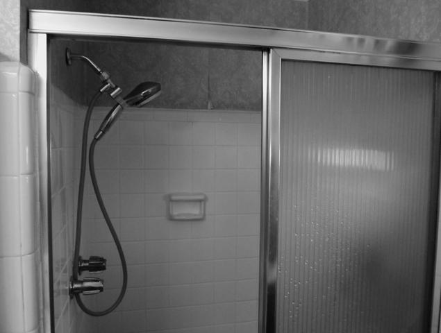 Close up view of small and outdated shower