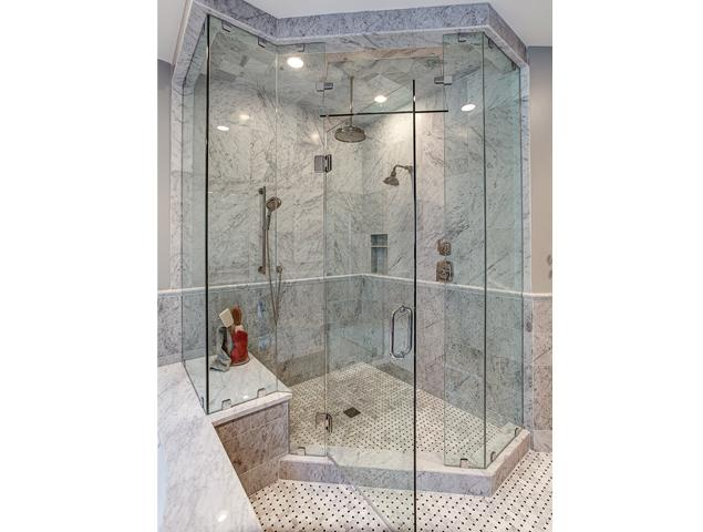 Close up of updated shower with new fixtures and seating